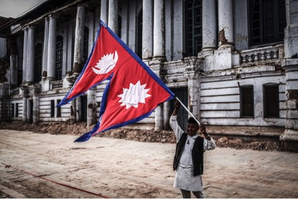 Nepali Man bearing Flag